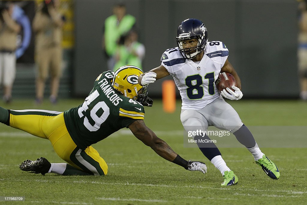 <a gi-track='captionPersonalityLinkClicked' href=/galleries/search?phrase=Golden+Tate&family=editorial&specificpeople=4500989 ng-click='$event.stopPropagation()'>Golden Tate</a> #81 of the Seattle Seahawks avoids the tackle from Robert Francois #49 of the Green Bay Packers at Lambeau Field on August 23, 2013 in Green Bay, Wisconsin.