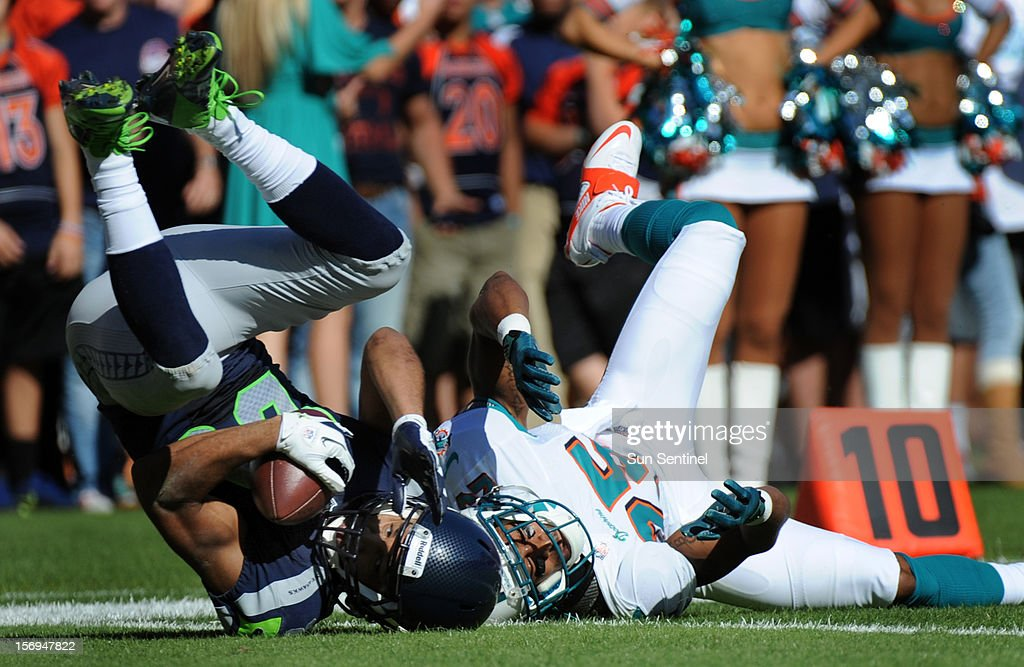 Golden Tate of the Seattle Seahawks catches a pass over R.J. Stanford of the Miami Dolphins in the second quarter at Sun Life Stadium in Miami Gardens, Florida, Sunday, November 25, 2012. The Miami Dolphins beat the Seattle Seahawks, 24-21.