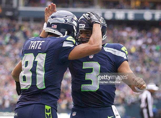 Golden Tate of the Seattle Seahawks celebrates a touchdown with teammate Russell Wilson during a game against the Minnesota Vikings at CenturyLink...