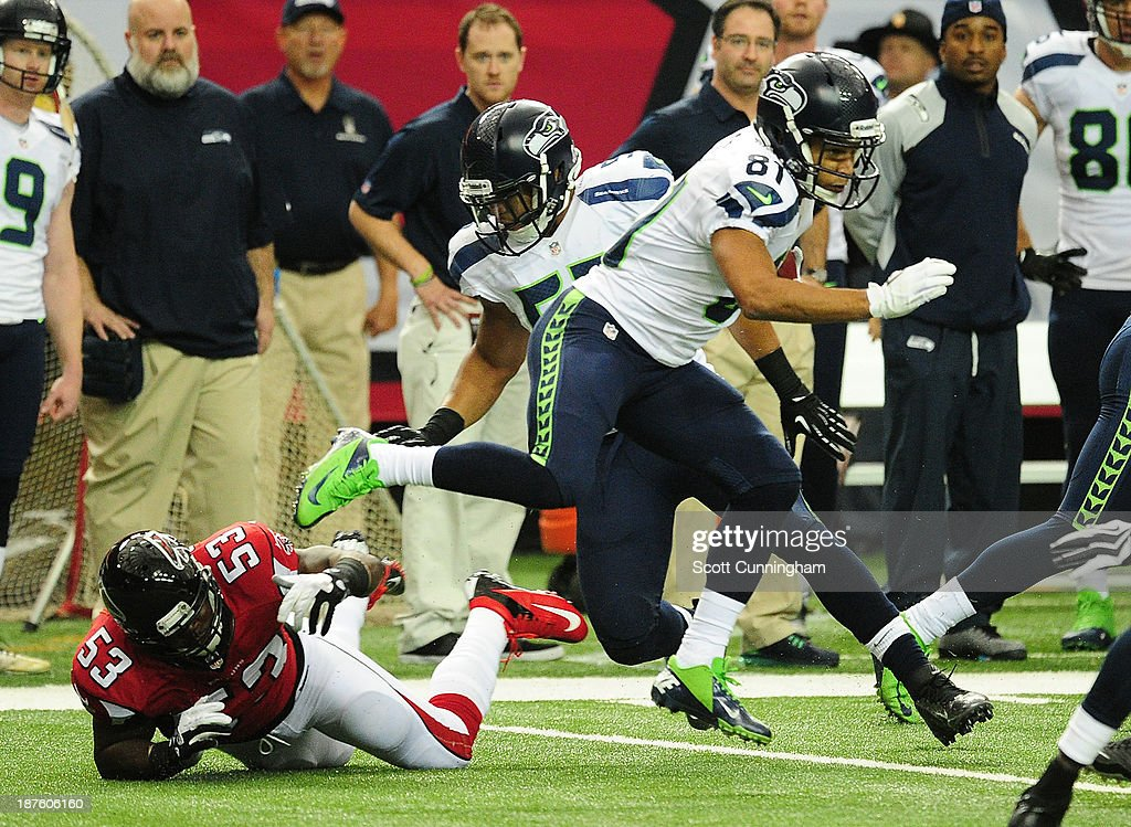 <a gi-track='captionPersonalityLinkClicked' href=/galleries/search?phrase=Golden+Tate&family=editorial&specificpeople=4500989 ng-click='$event.stopPropagation()'>Golden Tate</a> #81 of the Seattle Seahawks runs with a catch against the Atlanta Falcons at the Georgia Dome on November 10, 2013 in Atlanta, Georgia.