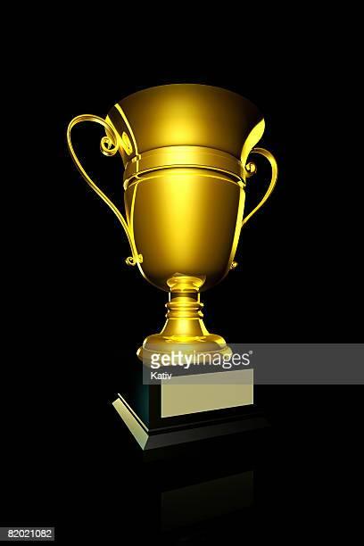 Golden trophy on black background.
