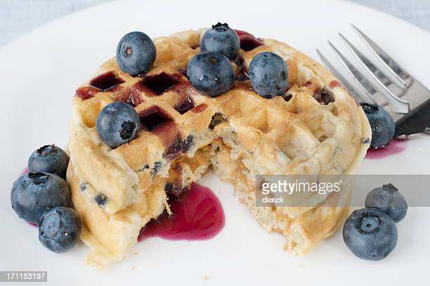 golden waffles with fresh blueberries