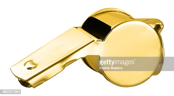 Golden whistle isolated against the white background : Stock Photo