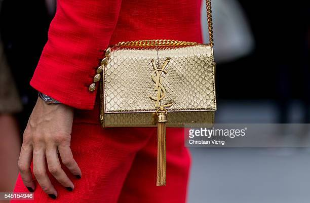 A golden Yves Saint Laurent bag outside Chanel during Paris Fashion Week Haute Couture F/W 2016/2017 on July 5 2016 in Paris France