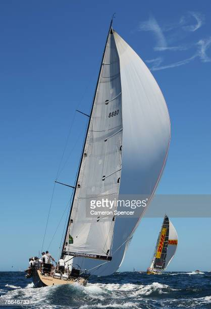 Goldfinger and DHL Daily Telegraph race during the start of the 63rd Sydney Hobart Yacht Race on December 26 2007 in Sydney Australia The fleet of 82...