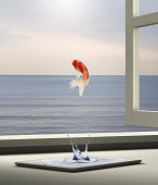 Goldfish is escaping to sea from tablet PC