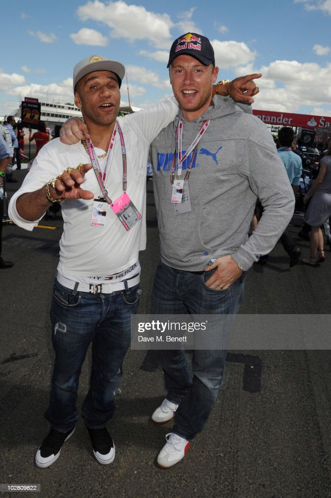 Goldie (L) and Freddie Flintoff visit the F1 paddock during race day ahead of the Formula One British Grand Prix at Silverstone on July 11, 2010 in Northampton, England.
