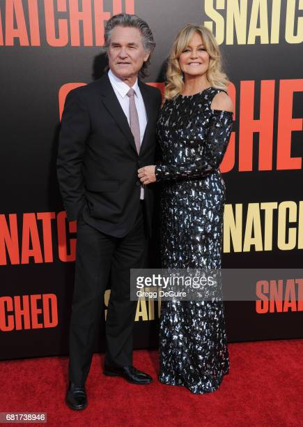 Goldie Hawn and Kurt Russell arrive at the premiere of 20th Century Fox's 'Snatched' at Regency Village Theatre on May 10 2017 in Westwood California