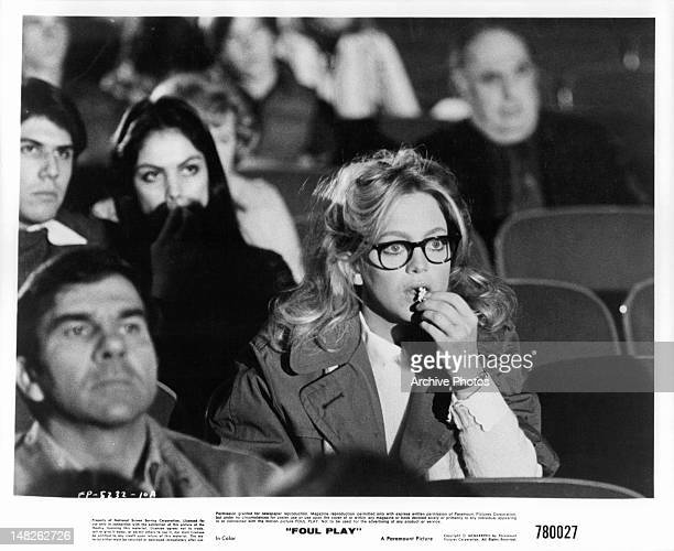 Goldie Hawn eating popcorn in movie theater in a scene from the film 'Foul Play' 1978