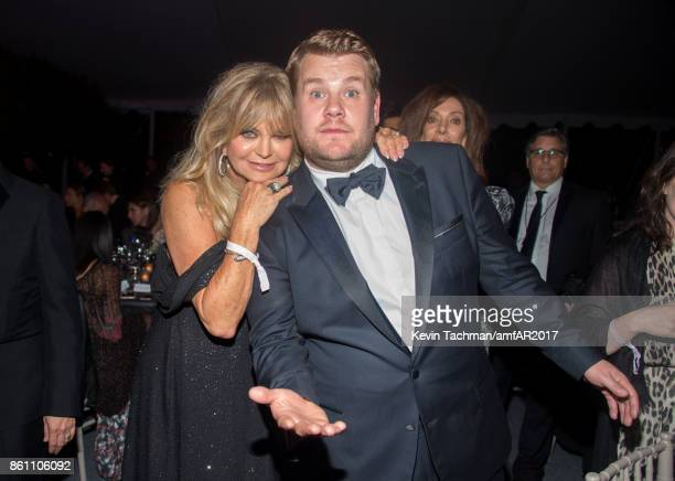 Goldie Hawn James Corden at amfAR Los Angeles 2017 at Ron Burkle's Green Acres Estate on October 13 2017 in Beverly Hills Californi