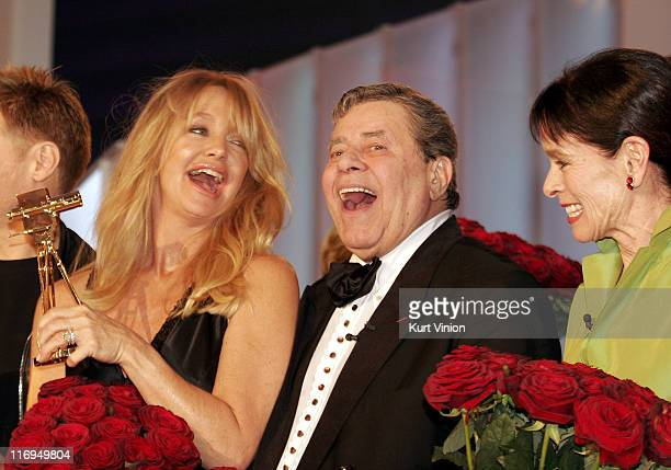 Goldie Hawn Jerry Lewis and Geraldine Chaplin with their awards for their contributions to entertainment