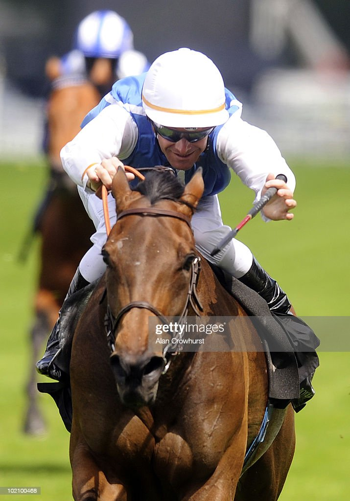 Goldikova and <a gi-track='captionPersonalityLinkClicked' href=/galleries/search?phrase=Olivier+Peslier&family=editorial&specificpeople=220682 ng-click='$event.stopPropagation()'>Olivier Peslier</a> win The Queen Anne Stakes on the 1st day of Royal Ascot at Ascot racecourse on June 15, 2010 in Ascot, England