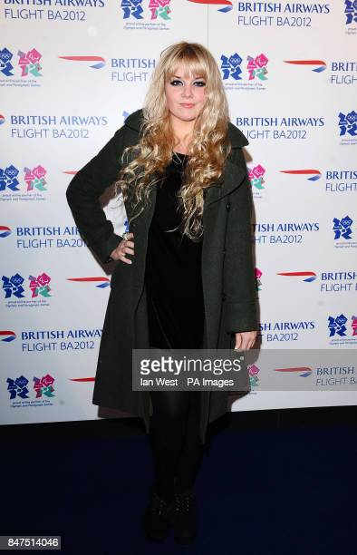DJ Goldilocks arrives at the airline themed popup venue Flight BA2012 on Shoreditch High Street in London