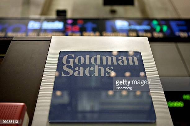 A Goldman Sachs Group Inc logo hangs on the floor of the New York Stock Exchange in New York US on Wednesday May 19 2010 Goldman Sachs Group Inc...