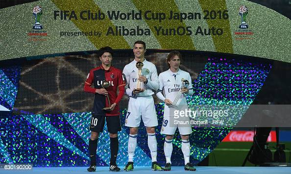 Goldon boot winner Cristiano Ronaldo of Real Madrid and 2nd place Luka Modric of Real Madrid and 3rd place Gaku Shibasaki of Kashima Antlers pose for...