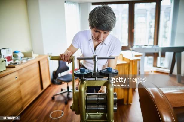 Goldsmith at work in her workshop