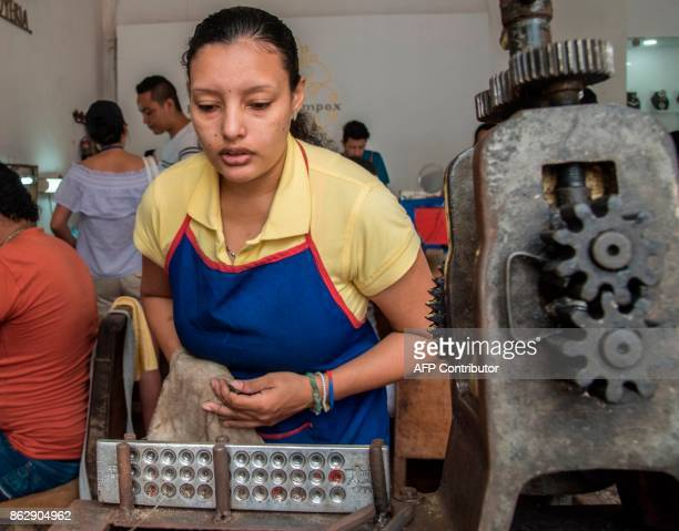 A goldsmith works in the creation of silver filigree jewellery in Mompox on 24 September 2017 The art of filigree a typical technique of Colombian...