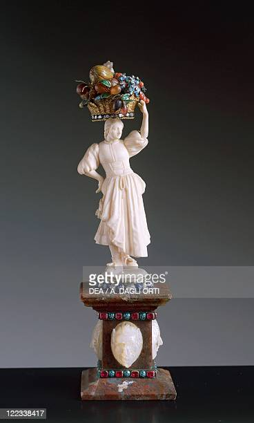 Goldsmith's art Germany 18th century Figurine of fruit woman seller in ivory enamelled gold diamonds pietre dure with agate base decorated with...