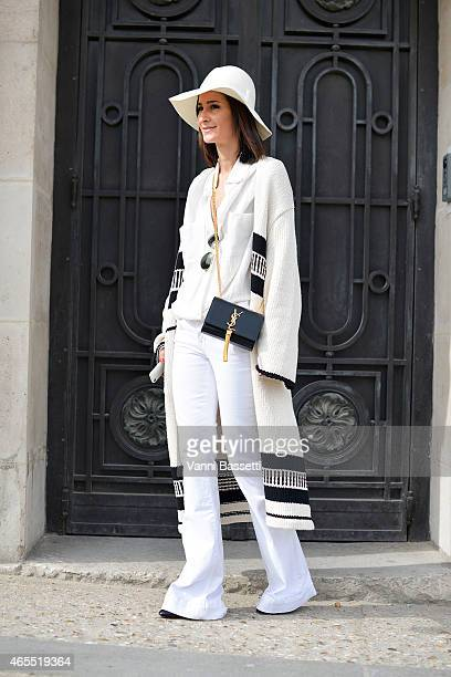 Golestaneh Mayer Uellner poses wearing a Zara coat J Brand pants and YSL bag on Day 5 of Paris Fashion Week Womenswear on March 7 2015 in Paris France