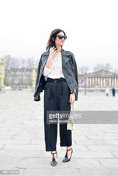Golestaneh Mayer Uellner poses wearing an Alexander McQueen jacket Zara top Stella McCartney pants Valentino bag and Celine shoes on Day 8 of Paris...