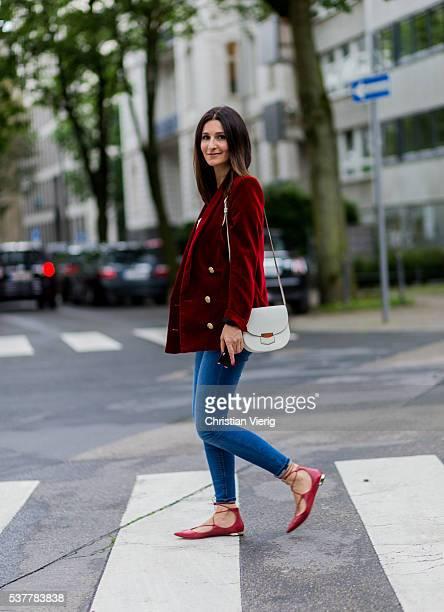Golestaneh MayerUellner wearing a red velvet blazer from Balmain white Zara tshirt blue high waisted skinny jeans from Zara red lace up ballerinas...