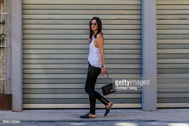 Golestaneh MayerUellner wearing a white racer back tank top from T by Alexander Wang black motorbike leather pants from Balmain for HM black...