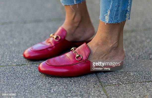 Golestaneh MayerUellner wearing red Princetown leather slipper from Gucci on August 25 2016 in Cologne Germany