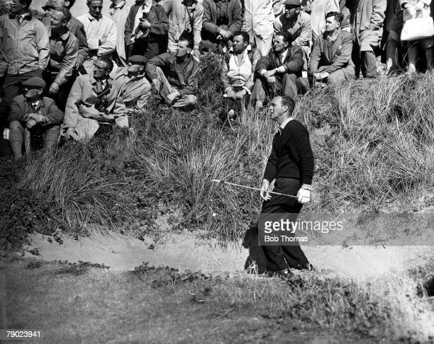 Golf 1961 British Open Golf Championship Royal Birkdale The eventual winner USAs Arnold Palmer plays a shot from a fairway bunker watched by Arnies...
