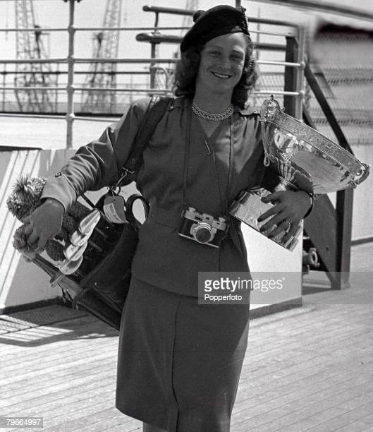 Golf 26th June American Ladies Open Golf Champion Mrs Mildred Zamarias holds the trophy as she stands aboard the liner Queen Elizabeth prior to...