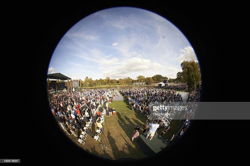 Fisheye view of fans in attendance seated during opening ceremony at Medinah CC. Fred Vuich F27 )