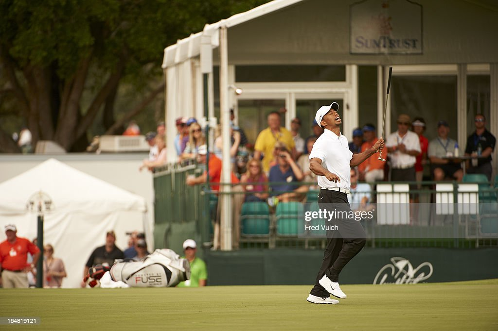 Tiger Woods upset after missing putt on No 17 green during Saturday play at Bay Hill Club & Lodge. Fred Vuich F337 )