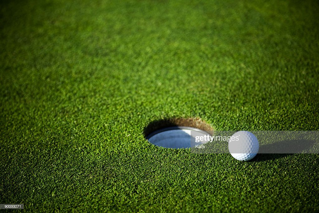 Golf ball almost in the hole