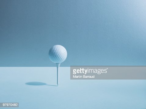 Golf ball balancing on tee : Stock Photo