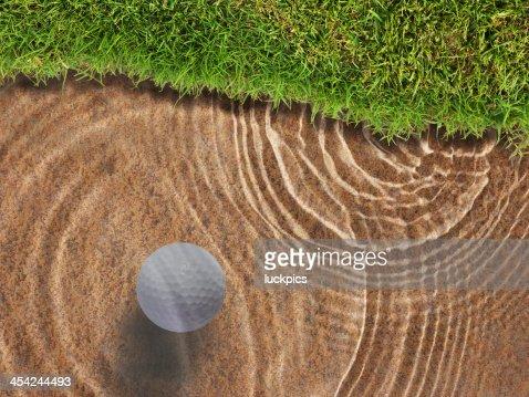 Golf ball drop in water bunker near green grass : Stock Photo
