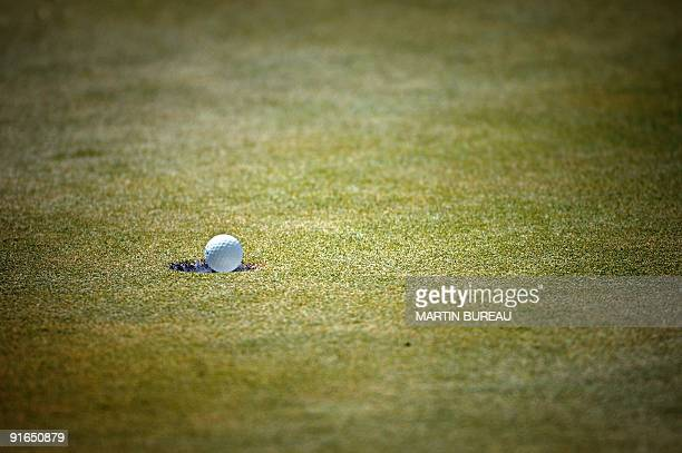 A golf ball falls in the hole during the Evian Masters 29 July 2006 in EvianlesBains central eastern France AFP PHOTO MARTIN BUREAU
