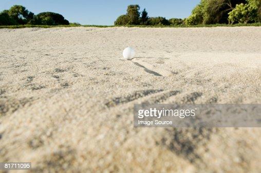 A golf ball in a sand trap