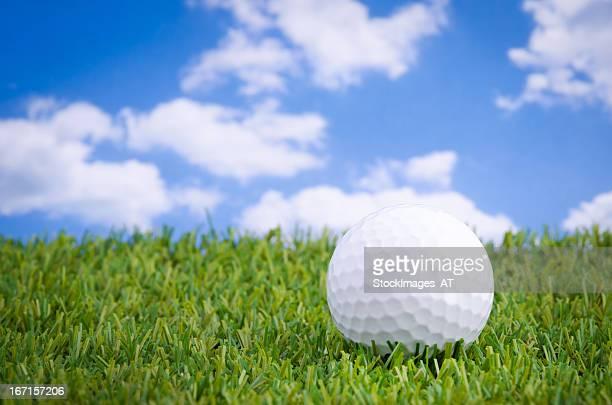 Golf ball lying on a green