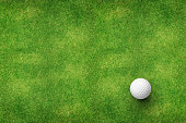 golf ball on grass top view