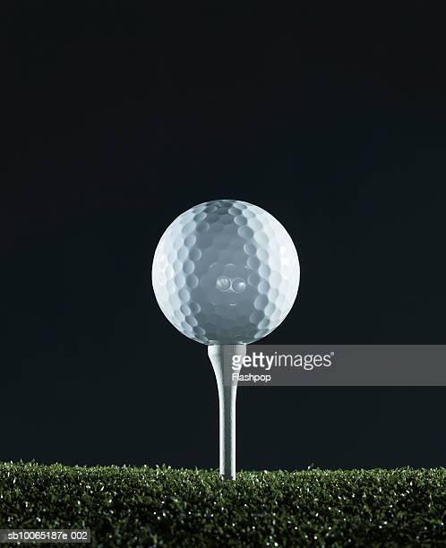 Golf ball on tee (surface level)