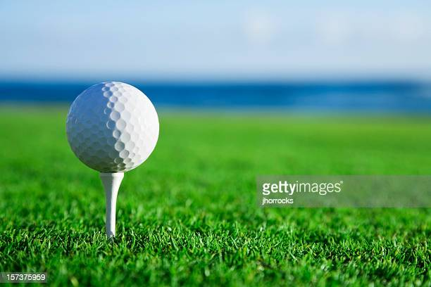 Golf Ball on Tee with Ocean View