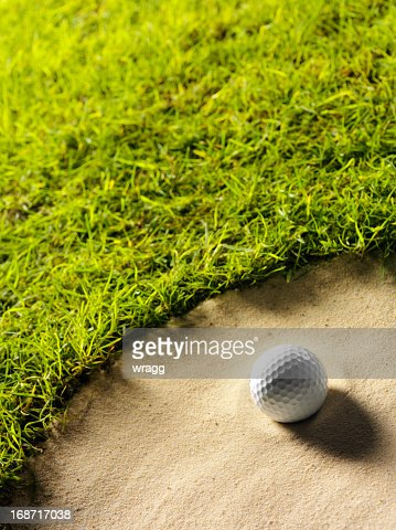 Golf Ball on the Edge of a Bunker