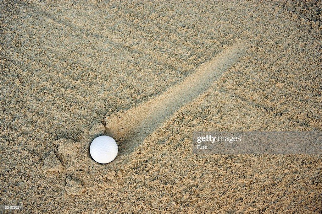 Golf Ball Rolling Through Sand Trap