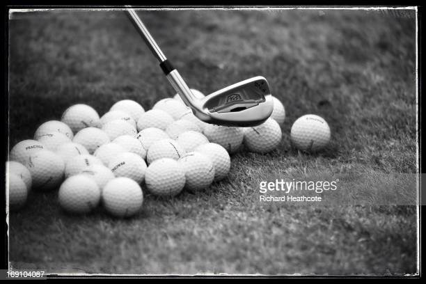 Golf balls are hit on the driving range during a practise day for the BMW PGA Championships at Wentworth on May 20 2013 in Virginia Water England