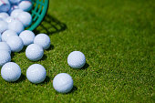 A bucket of golf balls at the driving range