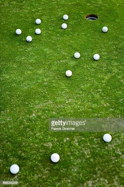 Golf balls on a putting green