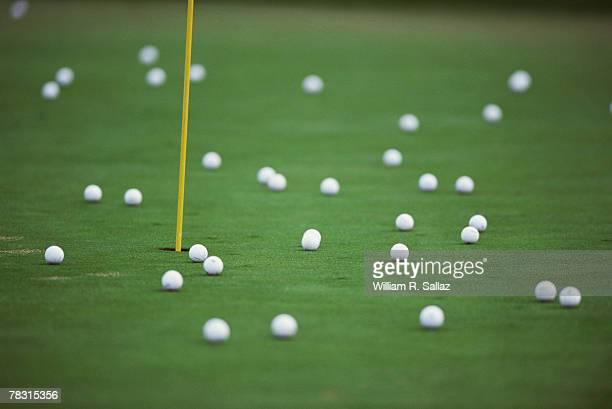 Golf balls on putting green