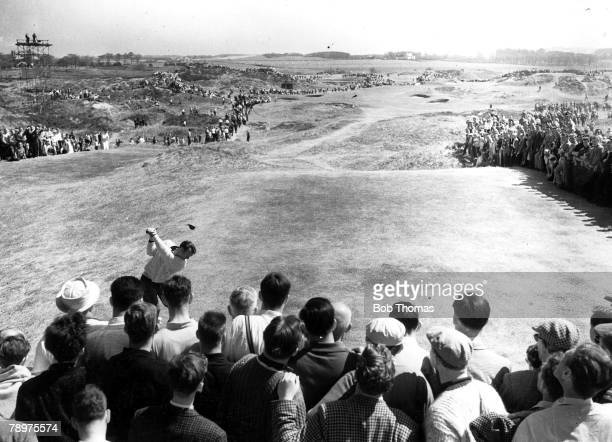 Golf British Open Championships Troon Scotland A picture of US golfer Arnold Palmer driving off from the tee watched by a gallery of spectators...
