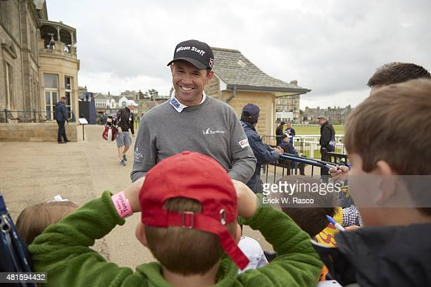 British Open Preview Padraig Harrington signing autographs for youth fans during Tuesday practice round at Old Course St Andrews Scotland 7/14/2015...