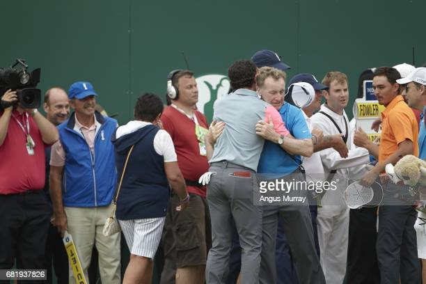 British Open Rory McIlroy victorious with swing coach Michael Bannon after winning tournament on Sunday at Royal Liverpool GC Hoylake England...