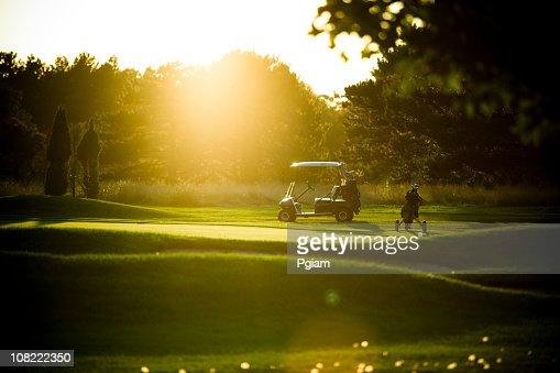 Golf cart at sunset